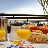 Hôtel Napoléon - Breakfast on the private terrace of a Sea View Room